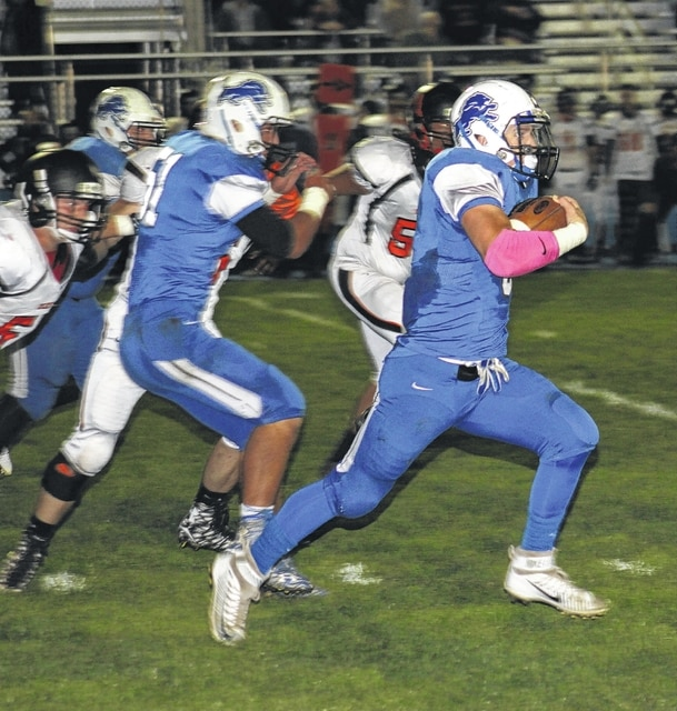 Timothy Robinson breaks a nice gainer for the Blue Lions during an SCOL game against Wilmington Friday, Oct. 9, 2015 at Gardner Park. Also pictured for Washington is Kameron Kearns (51).