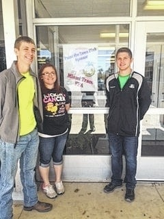 The Miami Trace FFA is currently raising funds through several efforts to support a life-saving program, Fayette County Memorial Hospital Partners in Pink Mammography. Miami Trace FFA officers Zachary Ault, Hannah Ellenberger and Kameron Rinehart post their first Paint the Town Pink sign at Miami Trace High School.