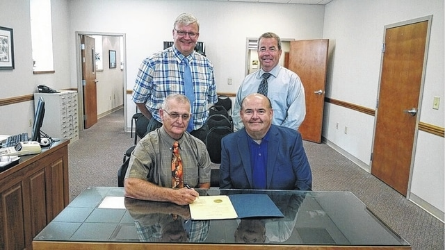 The Fayette County Commissioners declared Oct. 16-17 as Community Appreciation Days. Pictured from top left to bottom right are: Commissioner Dan Dean, Commissioner Tony Anderson, Chairperson Jack DeWeese, and Crossroads Christian Church Pastor Todd Maurer.