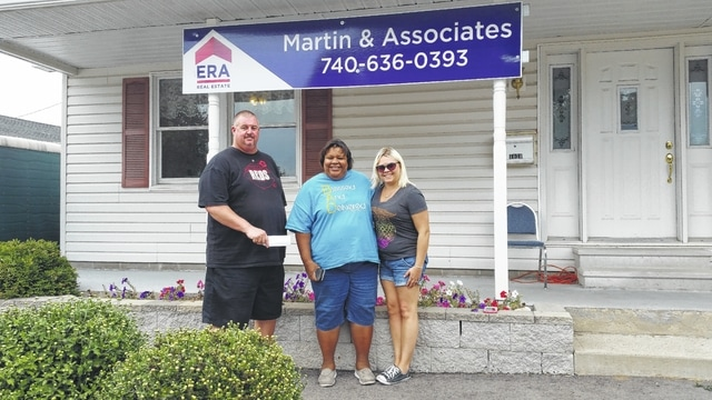 Pictured are Steven Armstrong, manager of ERA, along with Chiquita Nash of The Well and Molly Gruber from The Warehouse.