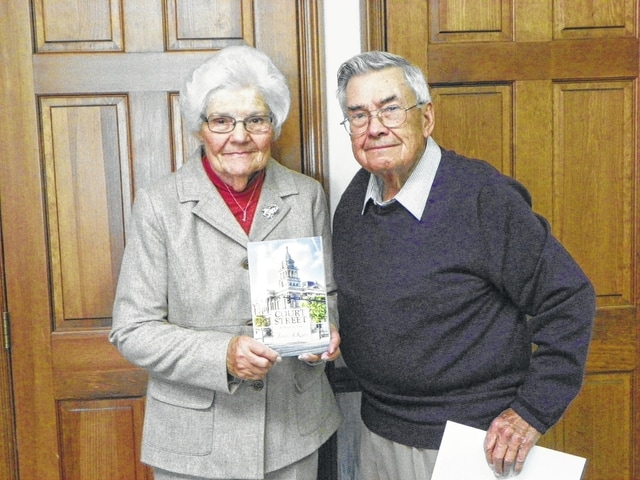 """Ann and Jim Kiger invite the public to a book signing for the newest Kiger novel, """"Court Street: A Street in Time,"""" on Nov. 20 at the Rusty Keg Crown Room from 7 to 9 p.m."""