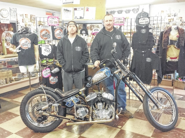 """Jason Stritenberger and D.J. Jenkins, co-owners of Court House Custom, pose with their bike that was recently featured on the cover of a national magazine, """"The Horse: Backstreet Choppers."""" With many hours of work into the bike, the owners said they were honored to be featured on the cover. The work of two additional Washington C.H. residents were also featured in the magazine."""