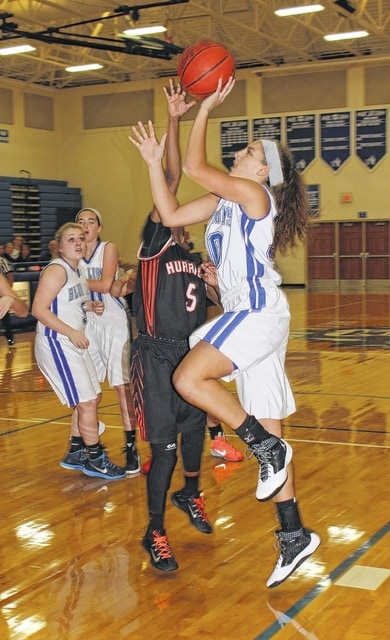 Washington freshman Hannah Haithcock takes the ball to the basket for two of her team-leading 19 points during a 62-51 win over Wilmington in the SCOL opener for both teams Tuesday, Nov. 24, 2015 at Washington High School. Mya Jackson (5) defends for Wilmington. Also pictured for Washington are Jaycie McRoberts and Savannah Wallace.