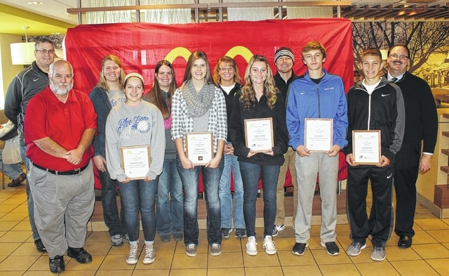 McDonald's of Fayette County and Jamestown honored Fall sports athletes from Miami Trace, Washington and Fayette Christian high schools Saturday, Nov. 14, 2015. Each of the athletes were interviewed by Randy Young on WCHO radio. (front, l-r); Randy Young, Brooklyn Wilson, Washington High School, volleyball; Hannah Adams, Fayette Christian High School, volleyball; Haylee Higgins, Miami Trace High School, tennis; Max Knisley, Washington High School, golf; Blake Pittser, Miami Trace High School, football; (back, l-r); Aaron Hammond, Miami Trace High School Athletic Director; Ashley DeAtley, Washington High School volleyball coach; Angela Harris, Fayette Christian School volleyball coach and athletic director; Kim Schirtzinger, Miami Trace High School tennis coach; Shannon Bartruff, Washington High School golf coach and Nick Epifano, owner and operator of McDonald's of Fayette County and Jamestown, sponsor of the awards.