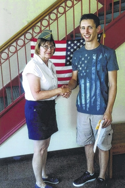 Micheal Wilt won first at the local, district and state levels before finishing second at the national level during the annual Amvet Americanism annual essay contest. He is pictured here with Amvets Post 3572 Commander Elaine Stalsworth.