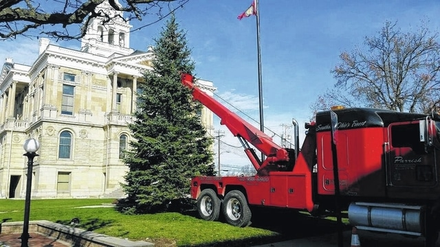 A large tree donated by Custom Landscape Contractors President Jaret Bishop was placed on the court house lawn recently thanks to efforts by Jim Garland and Parrish Towing and Transport. Stay with the Record-Herald as updates become available for the upcoming Christmas Tree Lighting Ceremony