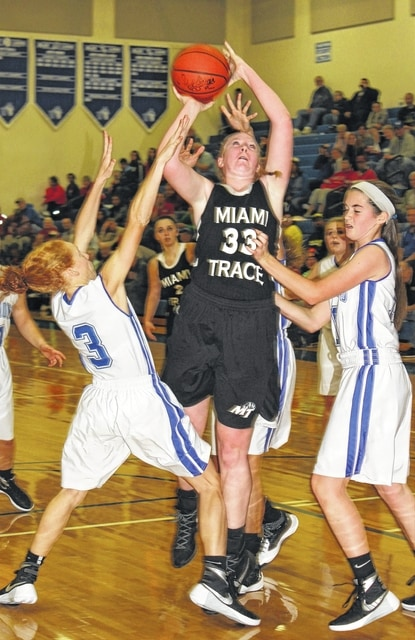 Miami Trace's Samantha Ritenour (33) puts up a shot during an SCOL game at Washington High School Saturday, Nov. 28, 2015. Defending for Washington are Alexis Gray (3) and Savannah Wallace.