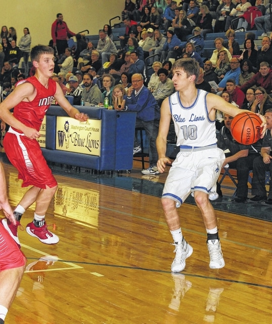 Washington senior C.J. Taylor (10) is guarded on the perimeter by Hillsboro sophomore Payton Bell during an SCOL game at Washington High School Tuesday, Dec. 15, 2015.