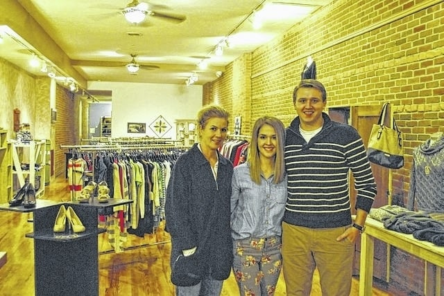 Left to right, Darena Pritchard and Kristen and Brandon Cade are the owners of Cade's Closet, a new boutique offering clothing, accessories, refurbished furniture and primitive crafts in downtown London.