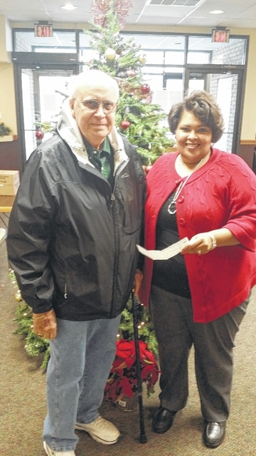 James Oughterson of the 32nd Degree Masons of Fayette County made a donation of $1,000 to The Meals on Wheels program. The check was accepted by The Commission on Aging Senior Nutrition Director Jowanna Hood.