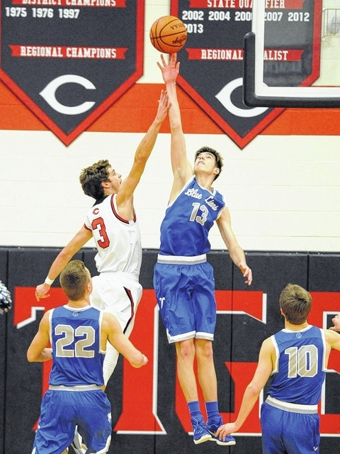 Washington junior Griffin Shaw (13) gets up to block a shot attempt by Circleville's Michael Camp early in the Blue Lions' 74-46 win Tuesday, Dec. 29, 2015.