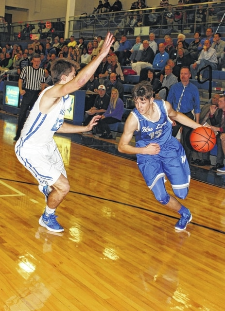 Washington Blue Lion junior Griffin Shaw, right, drives on Chillicothe senior Kristian Boltenhouse during an SCOL game at Chillicothe High School Friday, Dec. 4, 2015