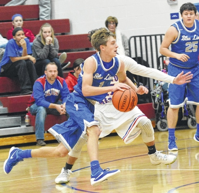 Washington senior Max Knisley (with ball) was the game's leading scorer with 34 points in an SCOL game at Clinton-Massie Friday, Dec. 18, 2015. Also pictured for the Blue Lions is Brian Wilson (25).