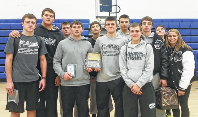 Members of the Miami Trace wrestling team after the tournament at Cambridge Saturday, Dec. 5, 2015. (l-r); Drake Litteral, Colin Wolffe, B.J. Anders, Matthew Hottinger, Wes Gandee, Austin Lovett, Jacob Tinkler, Tim Chaney, Coby Hughes, Jaymon Flaugher and Cassidy Tolliver.