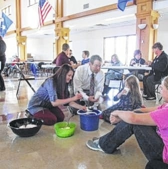 Students from the Charm-N-Farm 4-H club shared a lesson about world hunger during a recent meeting.