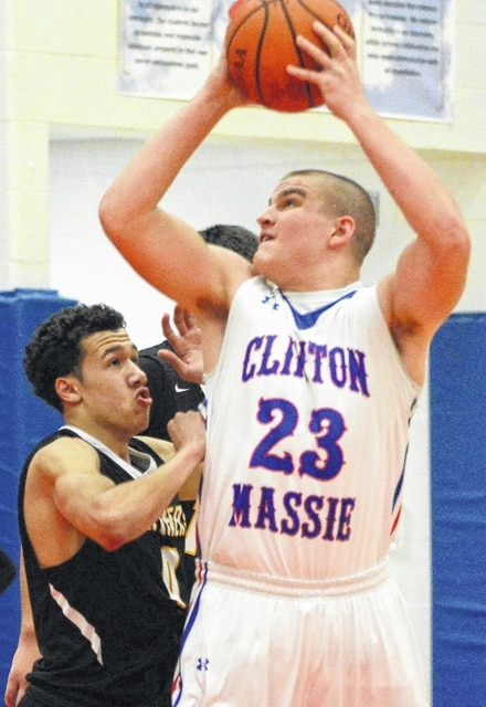 Miami Trace's DeAndre Pettiford (at left) defends against Clinton-Massie's Trey Uetrecht during an SCOL game at Clinton-Massie High School Friday, Jan. 15, 2016.