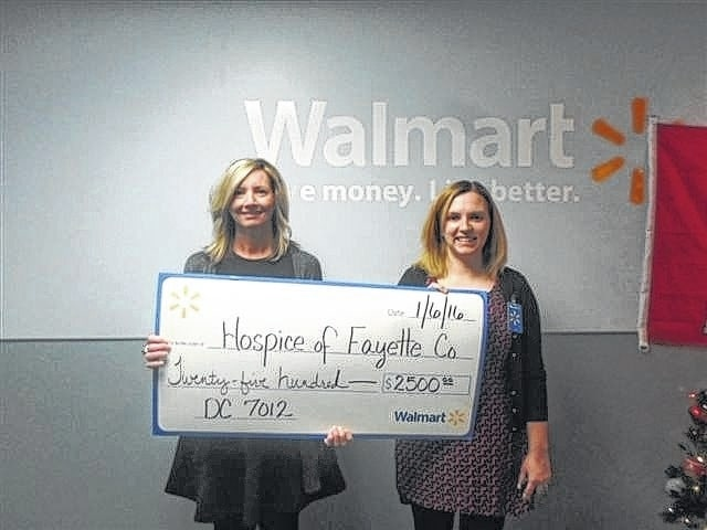 Holly Cottrill and Erin Rickman of Hospice of Fayette County recently accepted a grant from Walmart.