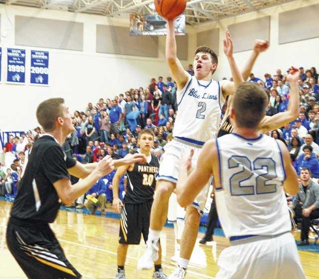 Washington Blue Lion junior Jarett Patton (2) puts up a shot during an SCOL game against the Miami Trace Panthers Friday, Jan. 8, 2016 at Washington High School. Also pictured (l-r); Darby Tyree and Blake Pittser of Miami Trace and Cameron Eckles of Washington.