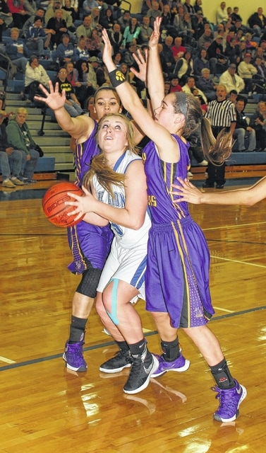 Washington senior Jaycie McRoberts is double-teamed during an SCOL game against McClain Saturday, Jan. 16, 2016 at Washington High School.