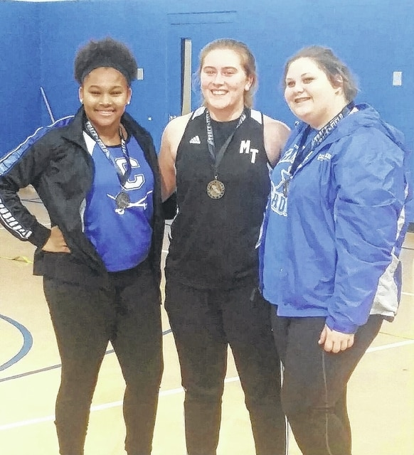 "Miami Trace's Katie Seyfang, above, center, began the indoor track and field season by winning the shot put competition at Chillicothe on Jan. 8, 2016. Seyfang's winning throw was 31' 10"". Pictured at left for Chillicothe is Janai Summers."