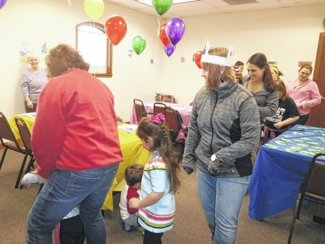 Grammy GG a.k.a. Cindi Grover, with granddaughter Addie, leads the group in the Bunny Hop at the Max and Ruby party held at Jeffersonville Branch Library.