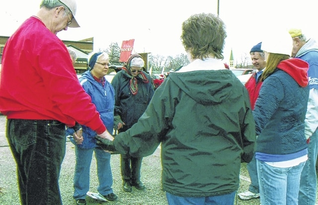 Members of the Fayette County National Day of Prayer Task Force are pictured praying before the Christmas Parade.