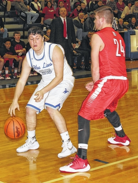 Washington junior Brian Wilson picks up defensive pressure along the baseline from Hillsboro's D.J. Brown during a Division II Sectional semifinal game at Southeastern High School Wednesday, Feb. 17, 2016.