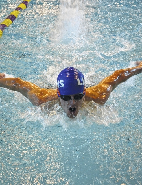 Washington's Brody Morris, shown swimming the butterfly stroke, recently set a new school record in the 100-yard freestyle event.