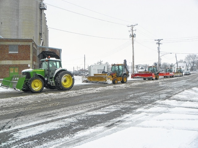 Custom Landscape Contractors was one of several commercial plows that could be seen at various locations around town after the county was blanketed by several inches of snow Monday night through Tuesday. Many county and state plow trucks could be seen patrolling roads and state routes trying to keep a continual Tuesday snowfall from accumulating too much.