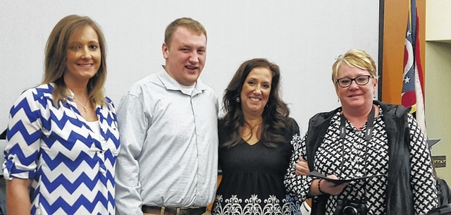 Beth Klosterman, Matthew Evans, and Toni Evans (l-r) present the newly established Debbie Ewing Memorial Scholarship to SSCC student Shana Sarbach (far right).