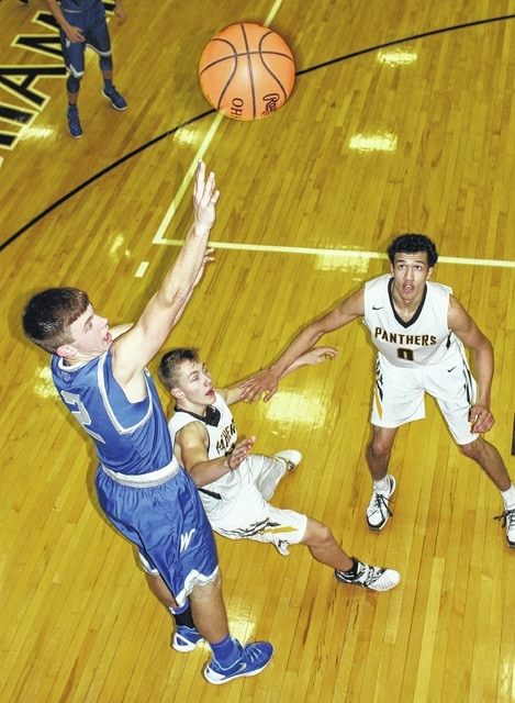 Washington junior Jarett Patton (left), puts up a shot during an SCOL game against Miami Trace Friday, Feb. 5, 2016 at Miami Trace High School. Pictured for the Panthers are (l-r); Mitchell Creamer and DeAndre Pettiford.