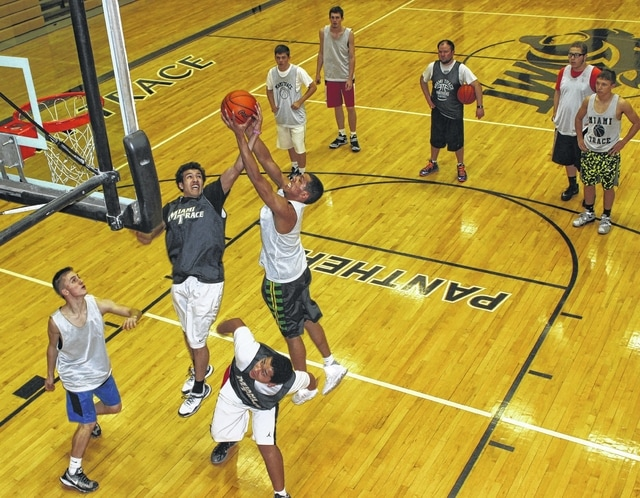 The Miami Trace Panthers were hard at work Wednesday afternoon, preparing for their District semifinal game against Fairfield Union, set for Friday at 8 p.m. at the Convocation Center on the campus of Ohio University in Athens. Above, DeAndre Pettiford (left), battles his twin brother, Tyrae Pettiford, for the rebound during a drill. Also pictured (front, l-r); Mitchell Creamer and Tiante Connell; (back, l-r); Ian Herbert, Darby Tyree, assistant coach Jeff Smallwood, Brad Card and Blake Pittser.