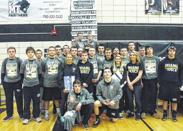 The Miami Trace wrestling team continued a long tradition of winning the McDonald's/Miami Trace Invitational, as they bested a field of 13 other teams to capture the 2016 title Saturday, Jan. 30. (kneeling, l-r); Coby Hughes, Gavin Moore; (l-r); Skyler Havens, Jaymon Flaugher, Brandon King, Dalton Bartley, Derek Moore, Jared Fenner, Cassidy Tolliver, Drake Litteral, Coach Ben Fondale, Timmy Chaney, Dylan Arnold, Jacob Tinkler, Bladeth Leaman, Coach Jacob Garringer, Emylee Grooms, Josh Liff, Colin Wolffe, Carleigh Fraley, B.J. Anders, Wes Gandee, Dylan Murphy; (back, holding trophy, l-r); Matthew Hottinger and Austin Lovett.
