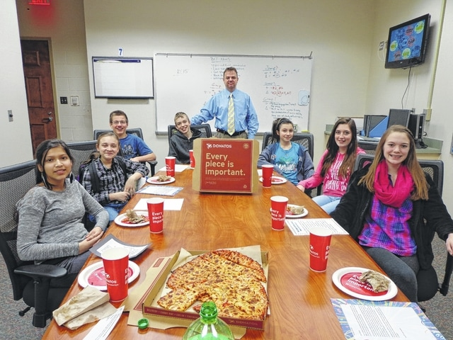 "Donatos recently provided pizza to these students at Washington Middle School as they celebrated ""Pizza with the Principals."" This is in appreciation for their selection as Students of the Month for February. They are chosen by their teachers because of the outstanding example they set for their peers in such areas as academic effort, good work ethic, kindness to others, and service to their school. Pictured from left: Andrea Fleming, Kayla Kesler, Thomas May, Cody Griffin, Mr. Montgomery, Assistant Principal, Courtney Southworth, Alayna Loeding and Catelyn Colter. Absent day of picture: Sean Willis."