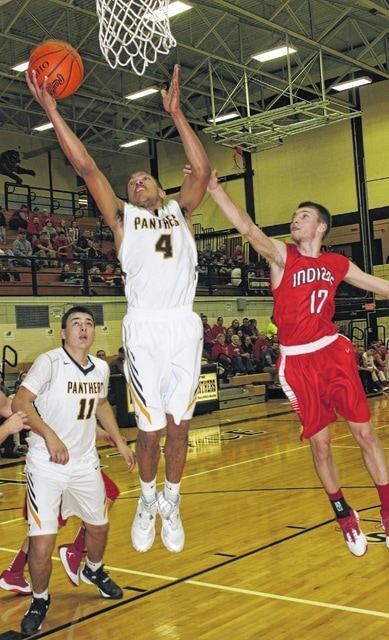 Miami Trace junior Tyrae Pettiford (4) takes the ball to the basket during an SCOL game against Hillsboro Friday, Feb. 12, 2016 at Miami Trace High School. Also pictured for the Panthers is junior Seth Leach (11). Pictured for the Indians is senior Logan Kibler.