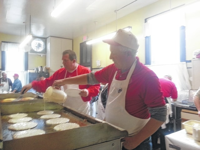 "Lions Jeff Fetters and Barry Bonham fry the Good Hope Lions Club's ""secret ingredient"" pancakes at the November 2015 dinner."