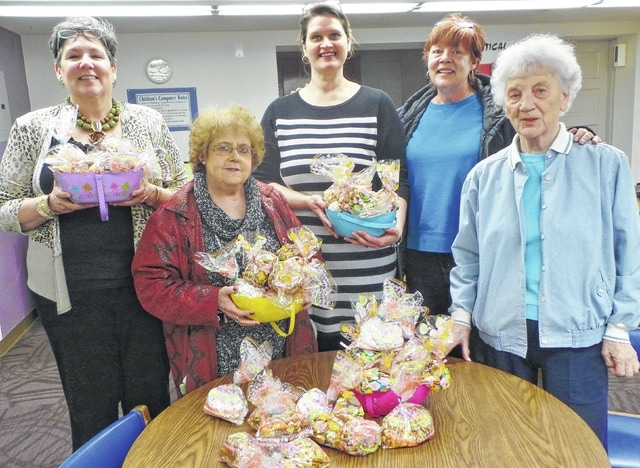 "The Service/Literacy Committee of Altrusa International of Washington C.H., Inc., recently brought springtime treats to the staff of Carnegie Public Library as its ""Random Act of Kindness."" Each year, each of the local club's five committees chooses a RAK to reinforce the Altrusa motto of ""Leading to a Better Community""; and because literacy is a major focus of the international association, Fayette County's local library frequently benefits. In fact, the two organizations have begun collaborating on a new literacy project, Little Free Libraries, the first of which will be constructed this summer in Bloomingburg near the town hall. Shown are (l-r) Anne Quinn, Head of Children's Services; Teresa Combs, chair of Altrusa's Literacy Committee; Sarah Nichols, Library Director; and Altrusans Teresa Persinger and Sonja Seiler. Not pictured are committee members Jeannie Bihl, Susan Dunn and Janet Martin."