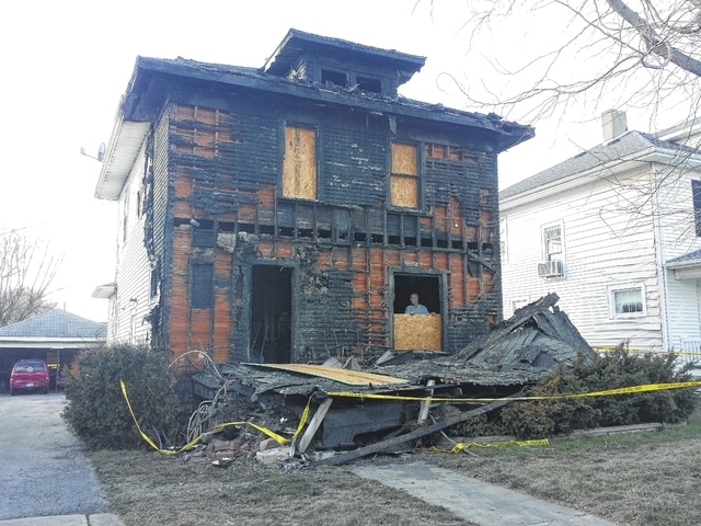 The house at 408 Van Deman Street suffered extensive damage after the porch caught fire shortly before midnight Sunday. The houses on either side also suffered damage while firefighters battled the blaze.