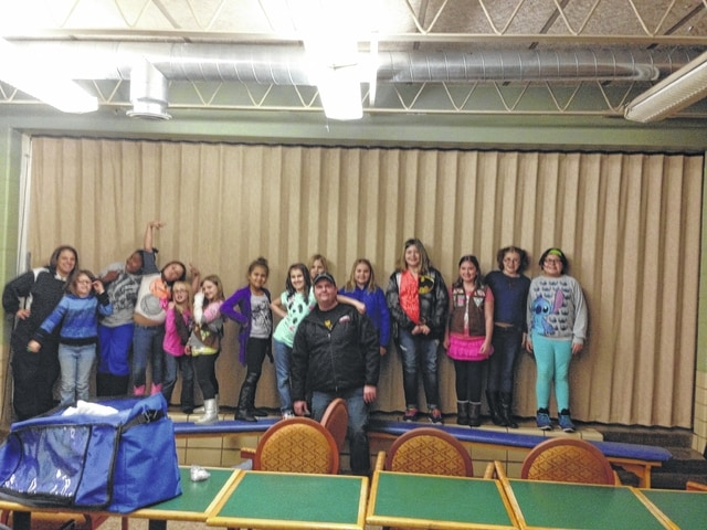 Mike Norman and Nicole Lehrman from East Ambulance visited Girl Scout Troop 480 Thursday evening. From left to right: Lehrman, Zoey Freese, Alaysia Dotson, Faith Dean, Abby Koutz, Madison Allen, Jayanna Guisinger, Rachel Huffman, Addylyn Mason, Zoe Self, Gloriana Adams, Jade Brown, Hayley Adams and Pyper Smith. In front is Norman.