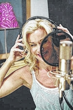 Country music artist Lorrie Morgan is pictured in the recording studio. She will be performing a benefit concert for Greenfield's Elliott Hotel in June.