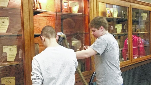 Pictured are Spencer and Trevor Minyo working.