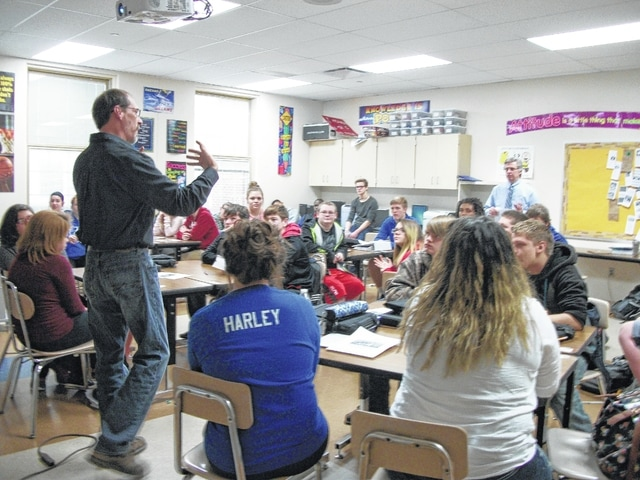 Rod Bryant, city building and zoning inspector, addressing Washington High School students in David Penwell's business class.