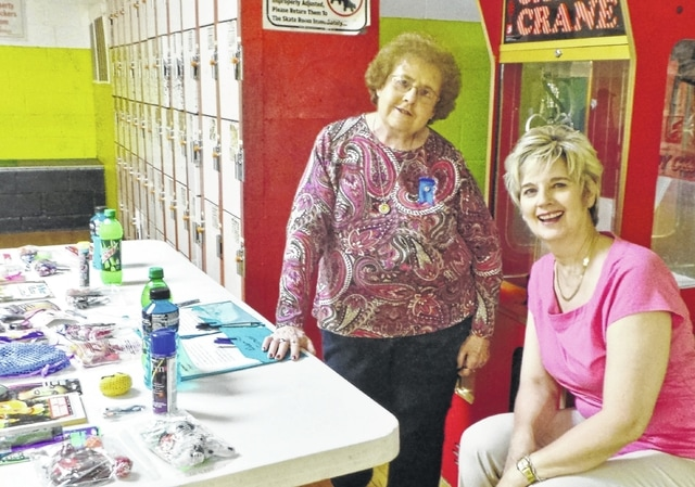 Altrusa International of Washington C.H., Inc., recently experienced a busy week. Last Tuesday, five members volunteered at a benefit skating party to help raise funds for a new freezer for The Well at Sunnyside. Atrusan Debra Grover spearheaded the project, which took place at fellow Atrusan Vicki Staffan's Roller Haven and which had been jump-started with a donation from First Presbyterian Church's Mission Council along with a promise of some matching funds from Modern Woodmen. Shown in the photo at the prize table are Altrusans Teresa Combs and Gamma White; also participating were Alice Craig and Lauran Perrill.