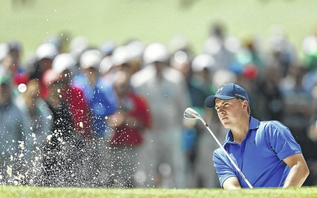 Jordan Spieth hits from a bunker on the seventh hole during the second round of the Masters on Friday in Augusta, Ga. Spieth shot a 74 in windy conditions to stay 4-under, one stroke ahead of Rory McIlroy.