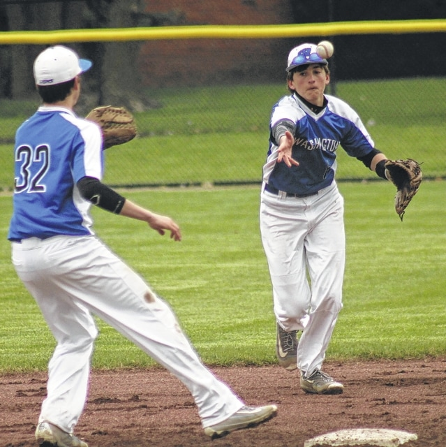 Washington's Eli Ruth, right, tosses the ball to Nick Barrett to get the force at second base during an SCOL game against Wilmington Friday, April 8, 2016. The game was played at Washington High School.