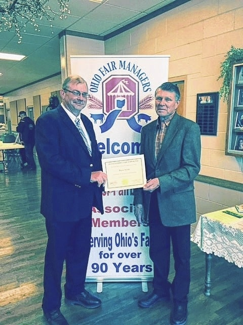 Wayne Arnold of Fayette County was recently awarded the Outstanding Fair Supporter Award by David Daniels, Ohio Agriculture Director. Arnold has been a 4-H advisor for 53 years and a director of the Fayette County Agricultural Society for 18 years.