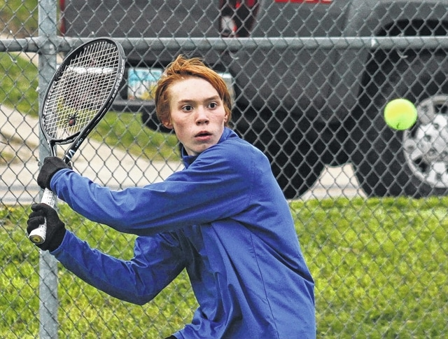 Washington's Grant Mustain makes the return on a very cold Monday, April 4, 2016 during an SCOL second singles match against East Clinton at Gardner Park.