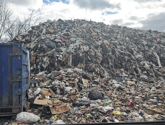 Cartwright Salvage Company is facing felony charges for disposing solid wastes on its property and operating a transfer facility without a license. This garbage pile accumulated to around 25-feet high and 50-feet long, according to authorities.