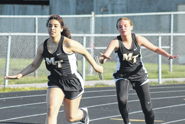 Deyona Branshaw (left) receives the baton from Kaitlyn Taylor in the 4 x 100-meter relay for Miami Trace in a meet with Xenia April 14, 2016. Along with Laralyn LeBeau and Alexis Smith, Miami Trace won the relay in a time of 57.6.