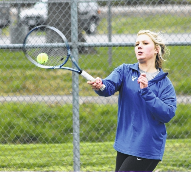 Madalyn Wayne hits the return for Washington during an SCOL first doubles match against Wilmington Friday, April 8, 2016 at Gardner Park.